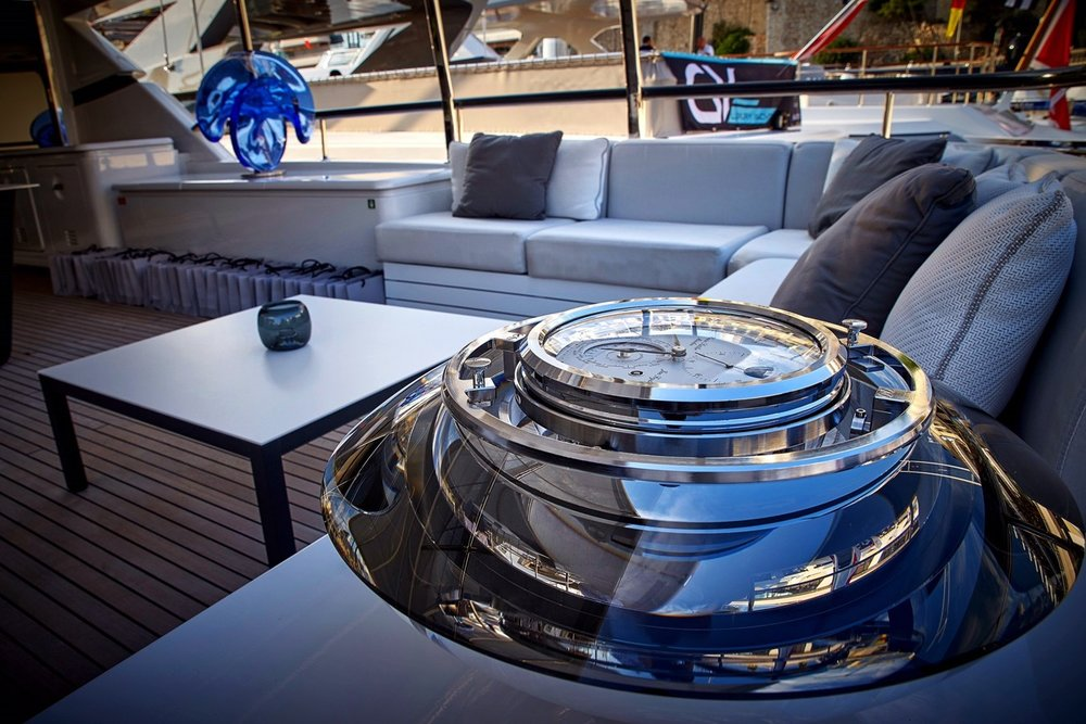 Jan Frydrych  and  Erwin Sattler Glass chronometer with  Vlastimil Beránek 's 'Ballerina - blue' sculpture in background on board of MY Elinor at Monaco Yacht Show 2017 Ⓒ  Crystal Caviar