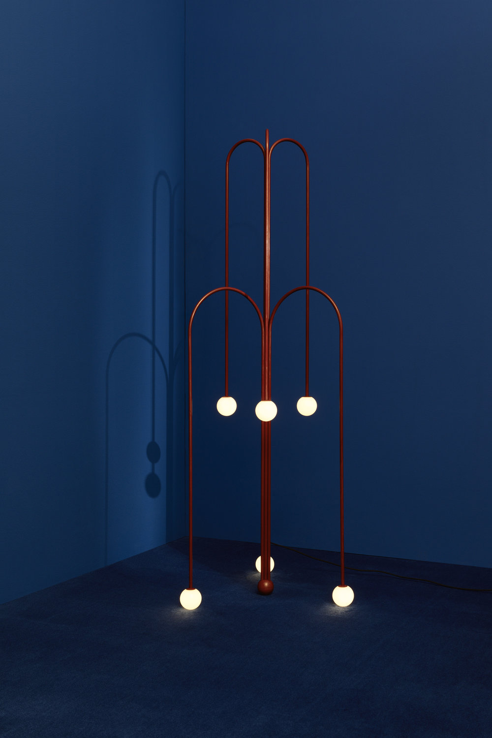 "Two ""Crossette"" floor lamps – Fontana Amorosa collection, UK, 2017, on display at Nilufar stand, Design Miam/ Basel 2018  Design: Michael Anastassiades 6 lights, Nilufar limited edition of 45 examples + 2 APs CE certificate provided Red patina brass, mouth blown opaline spheres Black braided flex, inline dimmer; size: diam 72 x h 180 cm 