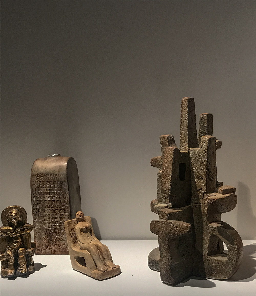 Lebreton Gallery - Design Miami/Basel 2018  Left to right: 'Personnage sur un Trône' - ceramic, 18 cm, 'Vase Empreintes' in glazed ceramic (31 cm) 'Personnage dans un Fauteuil' - ceramic (15.5 cm), and Cactus (47 cm) ca. 1970 by Eugene Fidler