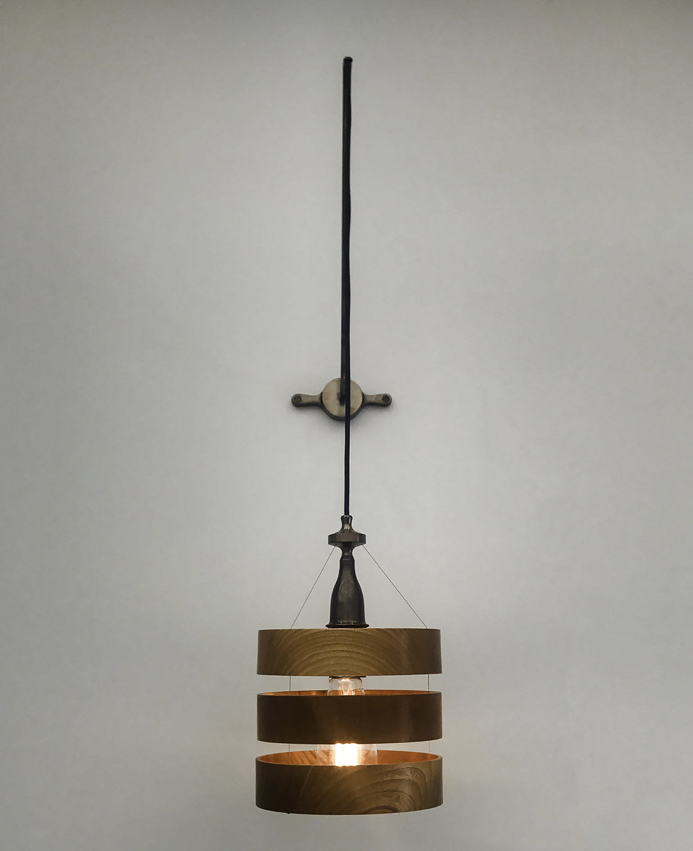 Treoran  wall light -  Wood, blackened brass; hand finished with natural oils and wax.