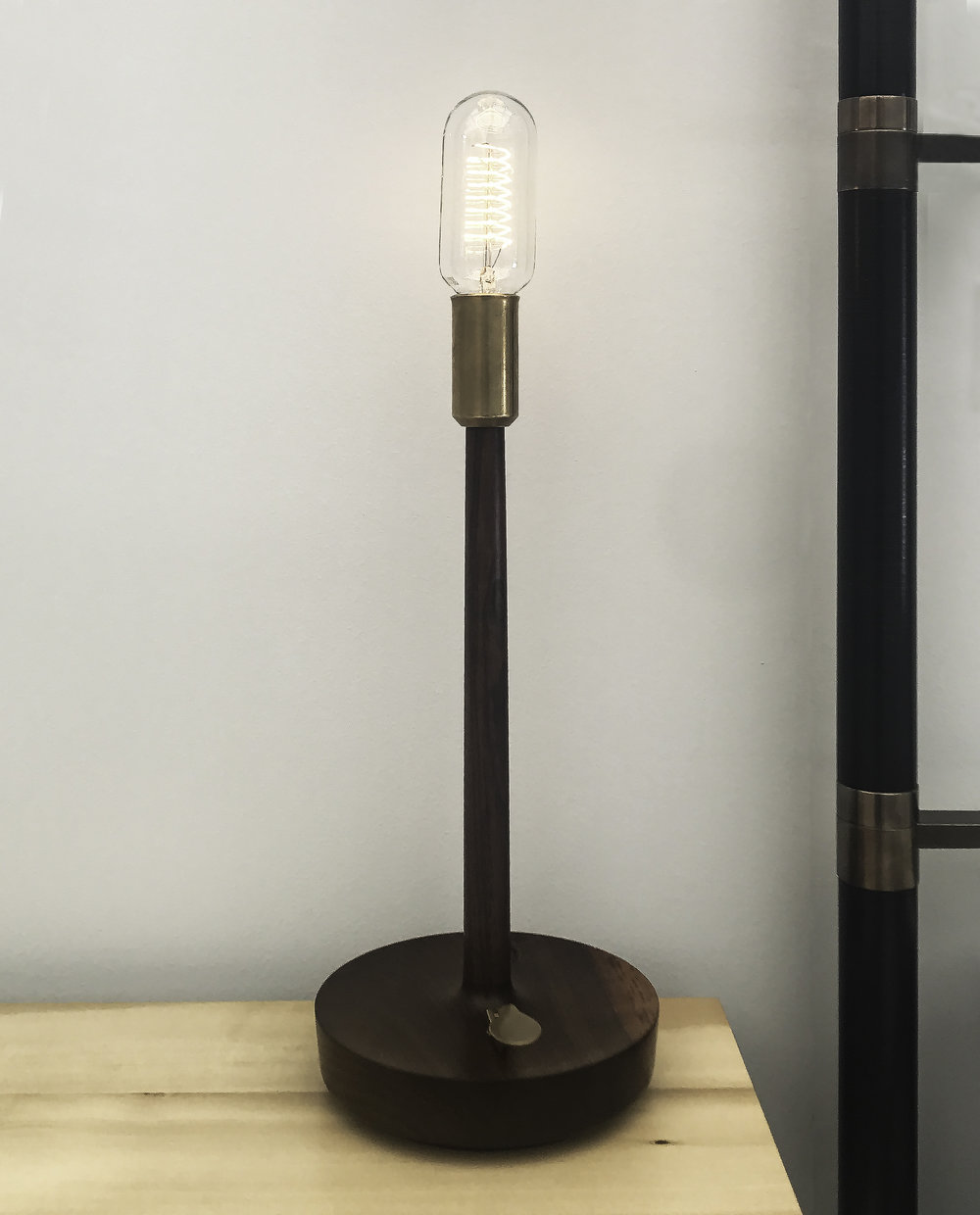 Copan  table lamp with brass on/ off switch  Brass, natural or blackened; hand finished with natural oils and wax.