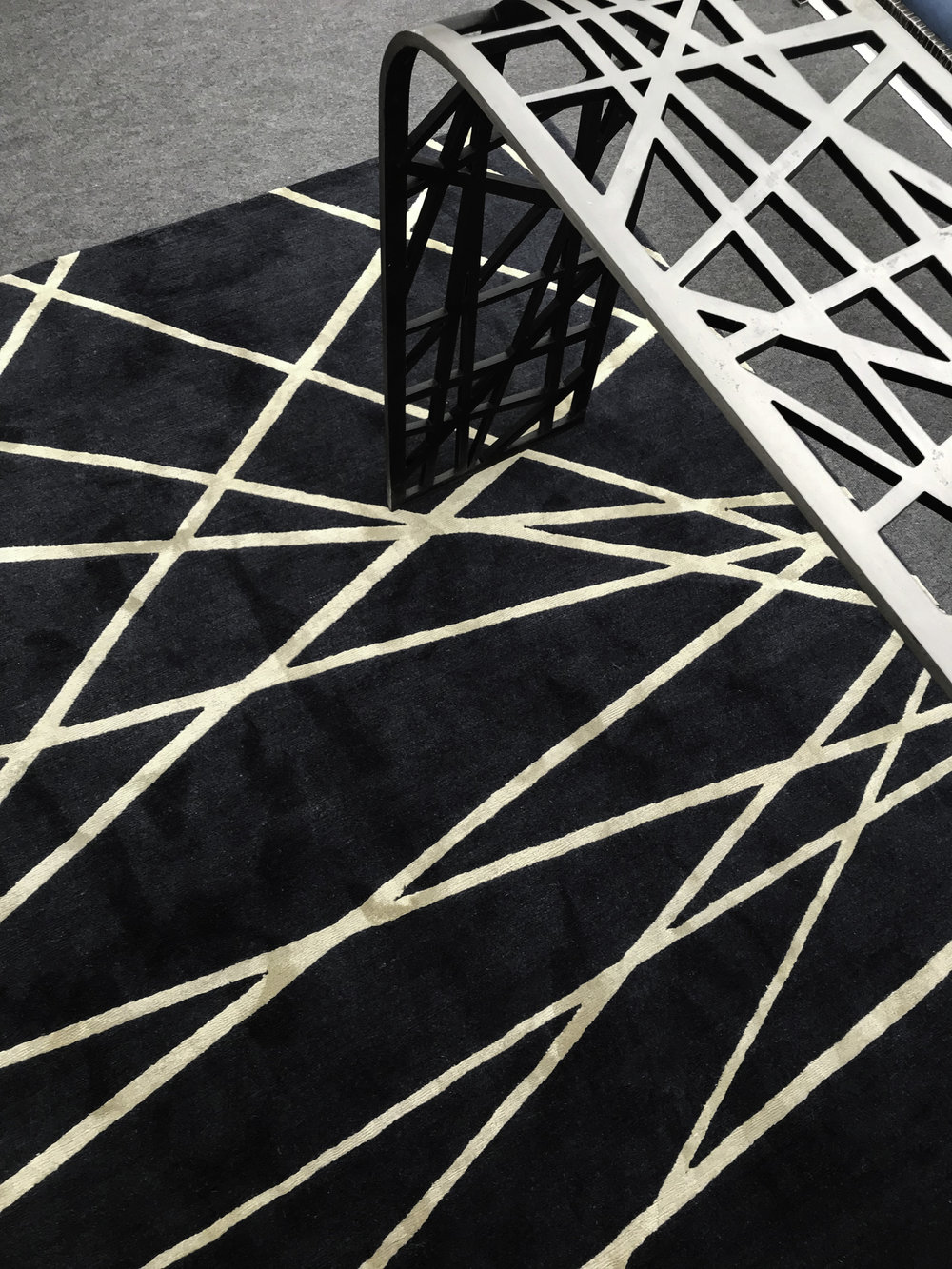 Detail of the  Birds Nest  console table at Decorex International 2018 ©Blackbird Bespoke  Inspired by the National Stadium in Beijing, China,  Birds Nest  is made from laser-cut panels of mild steel, heated and shaped by hand. The underside is hand-painted on purpose in a dark colour to highlight the bold patterned lines.
