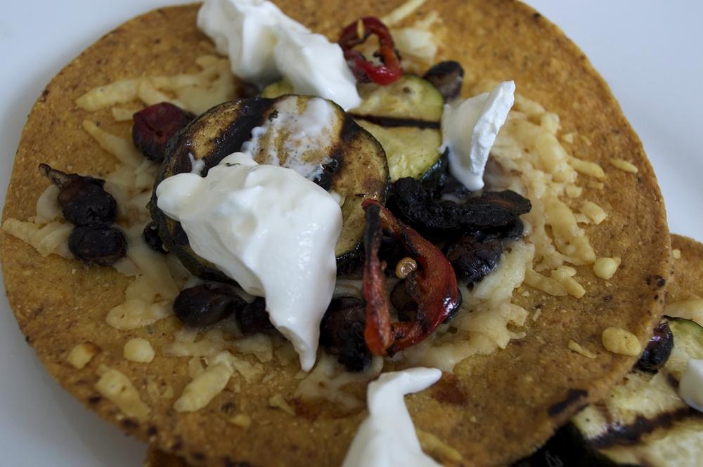 slow-cooked-black-bean-tostadas-zucchini-red-jalapeno-sour-cream-closeup.jpg