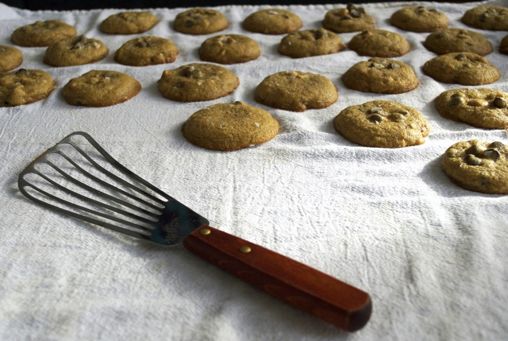 salted-chocolate-chip-cashew-cookies-cooling-spatula.jpg