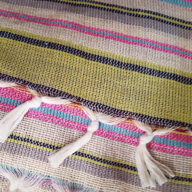 Close up of one of beautiful hand loomed pink and green striped Turkish towels. Such a versatile product especially in summer!  #myglobalmerchant #turkey #turkishtowel #textiles #homewares #summeressentials