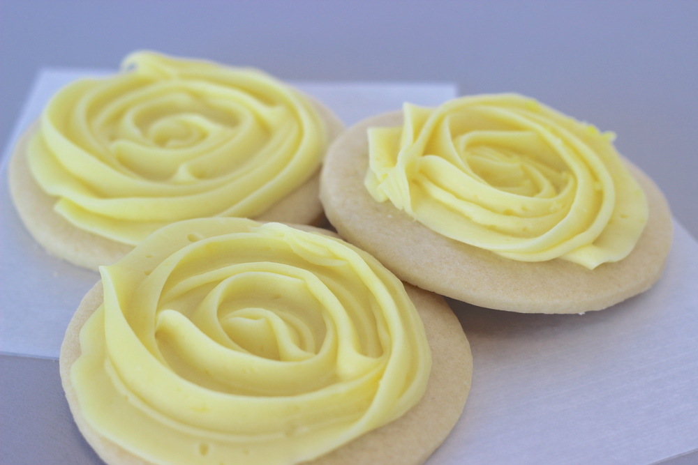 Lemon Sugar Classic soft sugar cookie topped with a fresh lemon cream cheese frosting.
