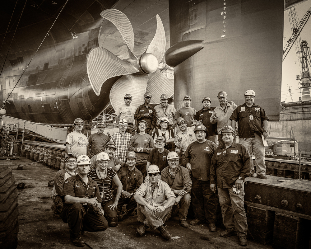Sometimes the group shot happens organically.  It all comes together with little or no production.  It's more of a feel, an emotion. Pride and satisfaction can be a great motivator.  Everyone proud of their part and happy to share that with peers.  This is part of the crew that built the Isla Bella - shot several hours prior to launch.  There's a formality and familiarity to these groupings - one that seems  passed down from generations of shipbuilders. This is one of 3 frames, no compositing, no production.