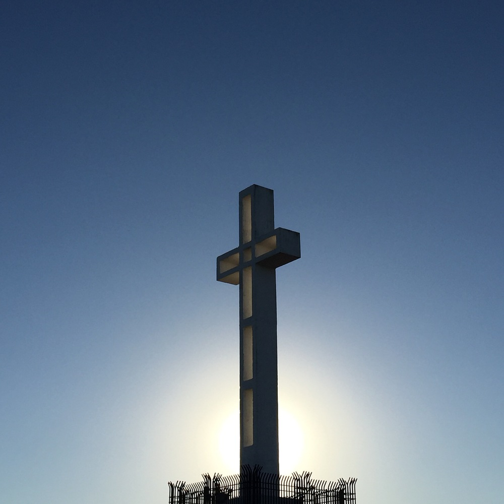 "The Mt Soledad cross sits atop the highest point in the posh San Diego neighborhood of La Jolla. The cross itself has undergone 2 ""resurrections"" and most recently a restoration. There have been 3 different crosses on the location since the original was built I 1909. The current cross is embroiled in constant litigation as it sits on federal land, formerly city owned. Opponents argue for its removal based on the separation of Church and State. A Korean War Memorial was built directly under the cross as a way of appeasement. But numerous courts have ruled for its removal. At last check, the cross still stands…"