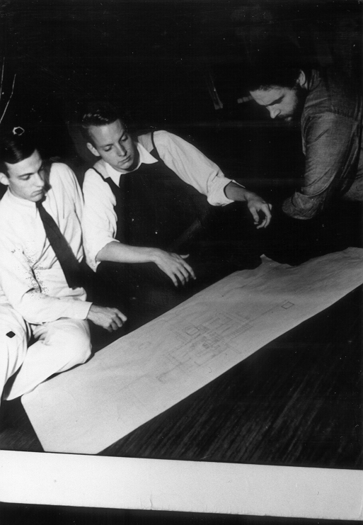 Fig. 1 > Conference just prior to client presentation of the Gunning House design. From left, Theodore van Fossen, Larry Cuneo, and Tony Smith.