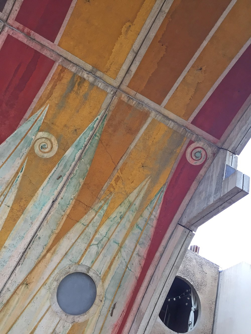 Pigment applied to concrete formwork provides lasting, integral color to massive vaults that provide shade in summer months