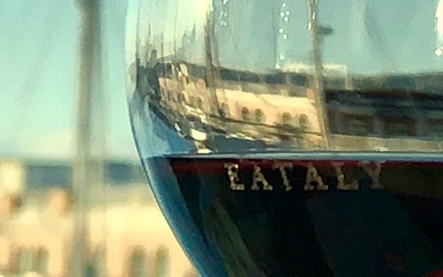 A glass of wine. #eataly #bastianich #vespa
