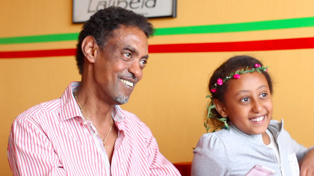 Isayas, the owner of the Ethiopian restaurant Ma'ed, with his daughter.