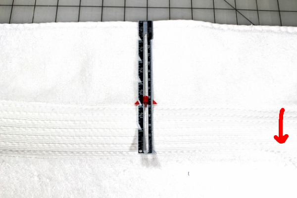 This towel has a border that can easily be used to line it up with the edge of the hoop.  You can see the hoop placement in the right corner.