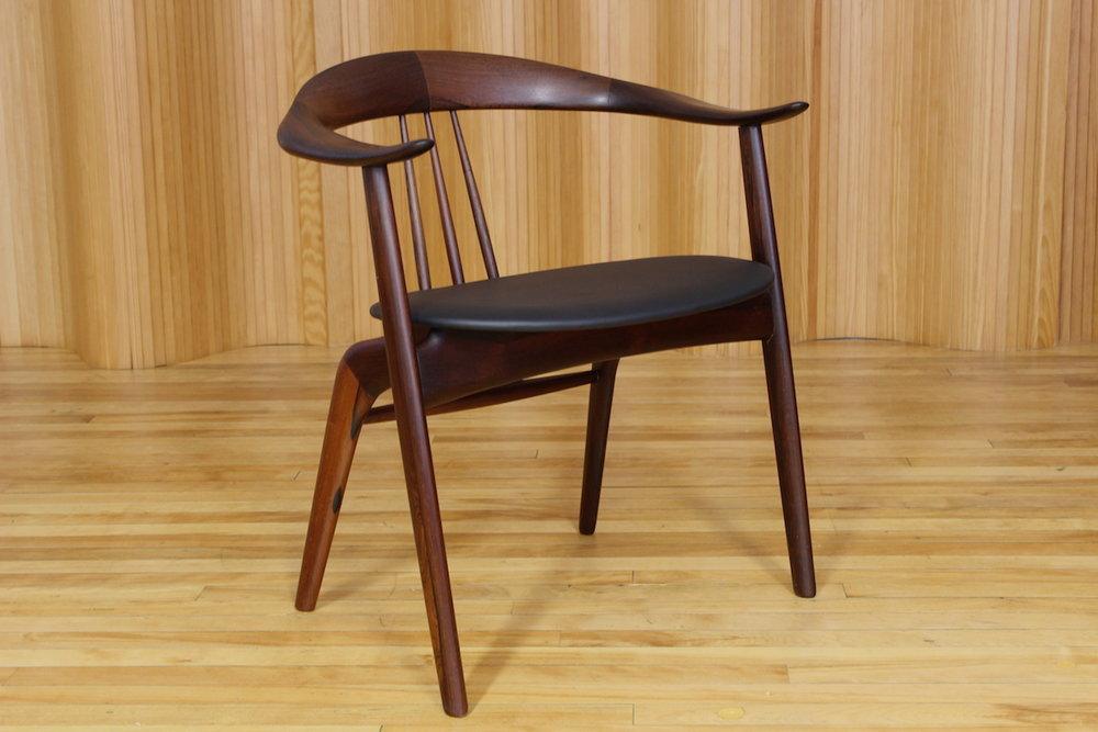 Arne Hovmand-Olsen rosewood armchair - manufactured by Mogens Kold, Denmark.