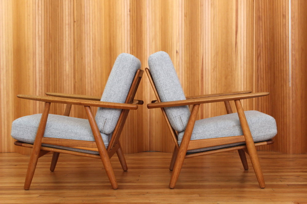 Pair of Hans Wegner model GE240 'cigar' chairs Getama Denmark 1955