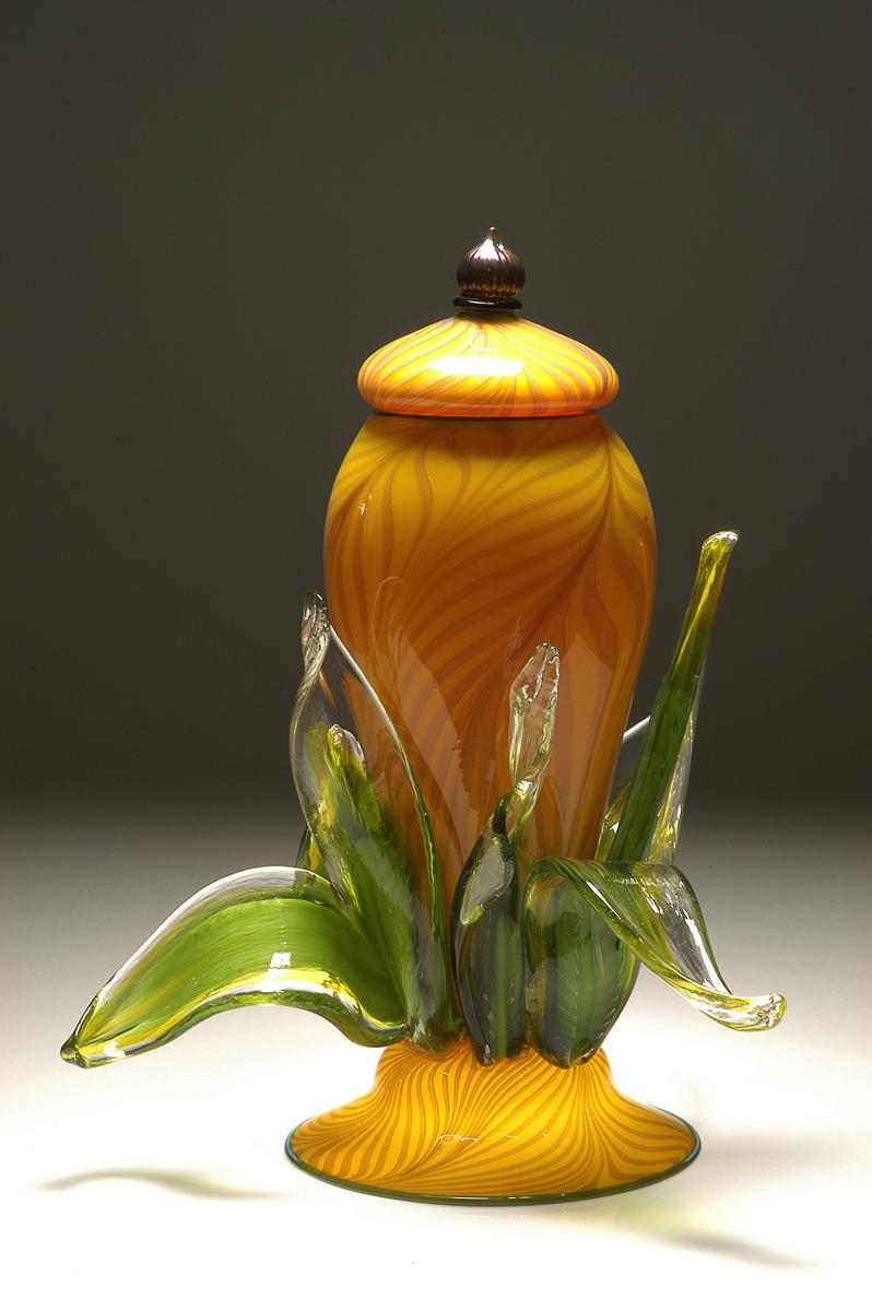 Lemon Passion lidded jar with leaves.
