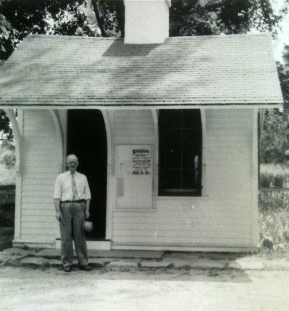 Another photo of Jock Gullen, possibly late 40s/early 50s. The sign on the bulletin board is advertising the South Salem Carnival on Aug 5-6th.