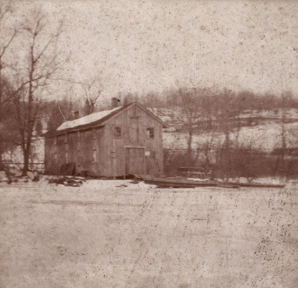 A view of the boathouse from a frozen Lake Waccabuc