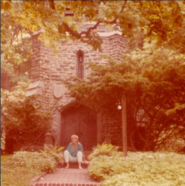 Marilyn Monroe seated in front of Mead Chapel