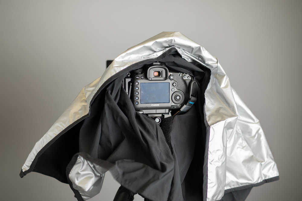 Black cloth is admittedly from the dark ages of large format sheet film, but if it works, who cares. This one has velcro to keep it in place and is conveniently light silver on the outside to reflect the heat from the summer sun.