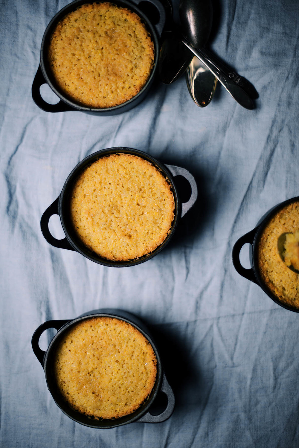 Cornmeal And Coconut Rose Water Cakes A Brown Table