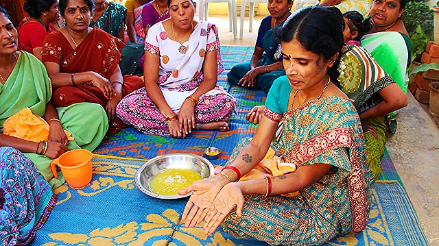 Credit: Water.org  Local women in India leading and participating in a local hygiene education session, learning about the importance of hand-washing.