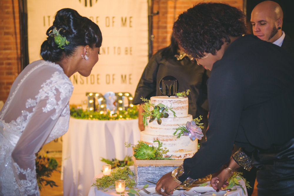 Admiring their cake while Raquel their Event Planner got it ready!
