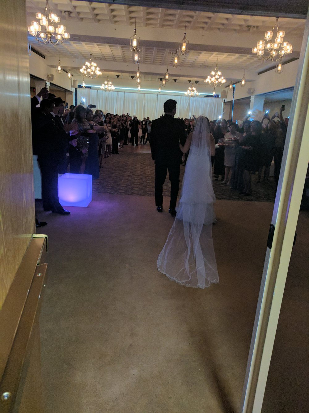 The Bride and Groom making their grand entrance into the reception!