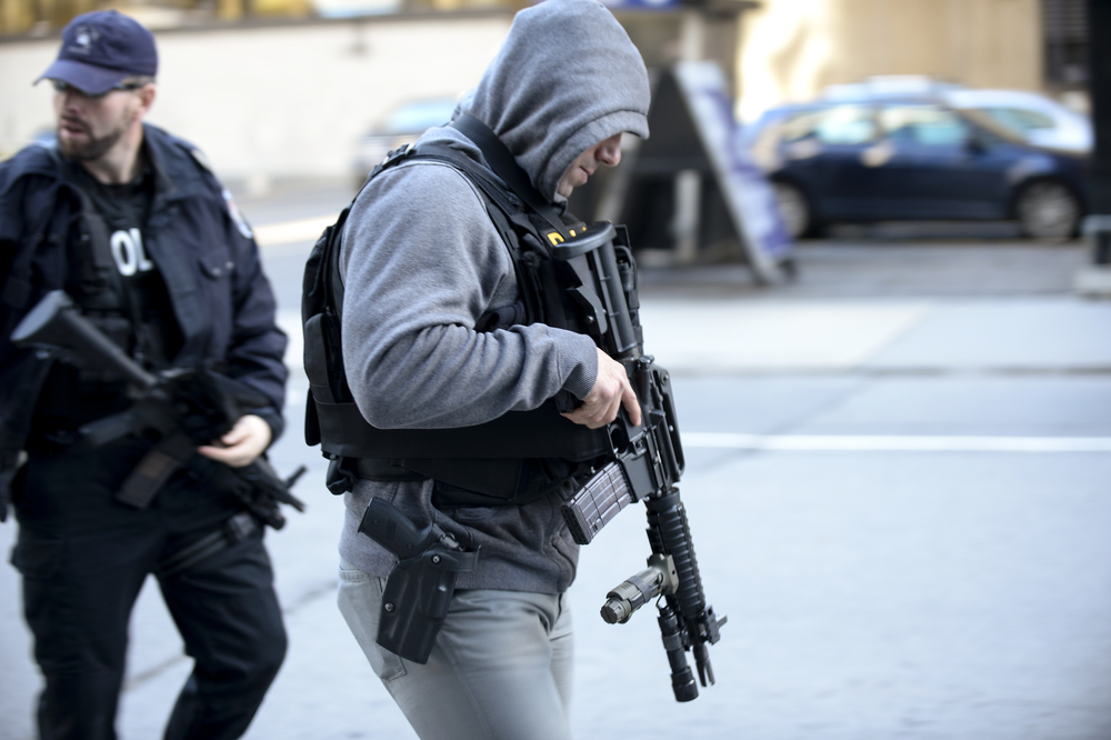 OTTAWA, Ont. (22/10/14) - Ottawa saw some heavy policy presence with assault rifles after a deadly shooting in the capital on Wednesday Oct. 22, 2014. A shooter had opened fire on a military reservist who was standing guard at the tomb of the unknown soldier at the National War Memorial. The shooter stormed Centre Block where he was later gunned down. Photo by Andrew Lahodynskyj