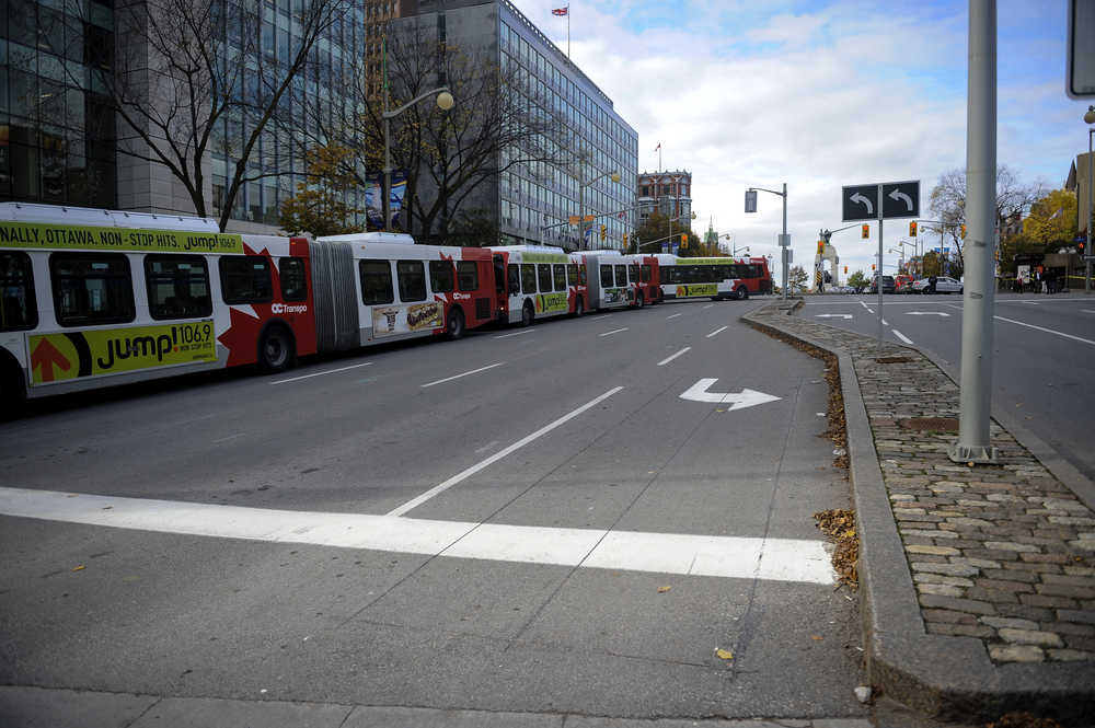 OTTAWA, Ont. (22/10/14) - Buses line up after being forced to take multiple detours in Ottawa after a dead shooting that happened around 9:50 a.m. on Wednesday Oct. 22, 2014. A shooter had opened fire on a soldier who was standing guard at the tomb of the unknown soldier. Photo by Andrew Lahodynskyj