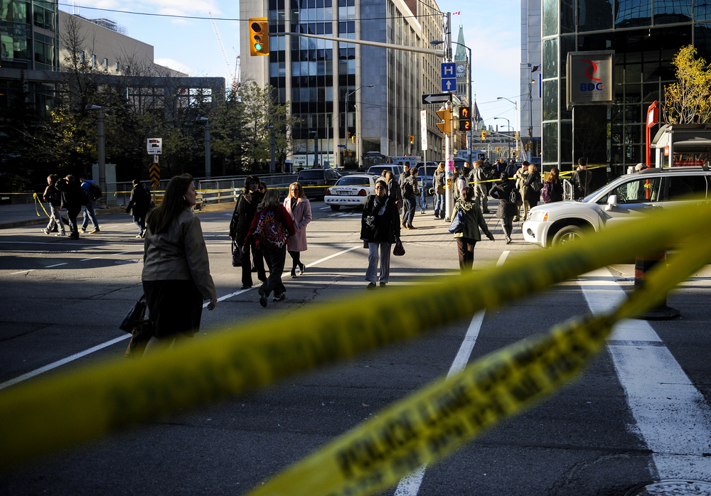 OTTAWA, Ont. (22/10/14) - People make their way from the downtown Core of Ottawa after being on lockdown for multiple hours after a deadly shooting in Ottawa, Ont., on Wednesday Oct. 22, 2014. A shooter had opened fire on a military reservist who was standing guard at the tomb of the unknown soldier at the National War Memorial. The shooter stormed Centre Block where he was later gunned down. Photo by Andrew Lahodynskyj