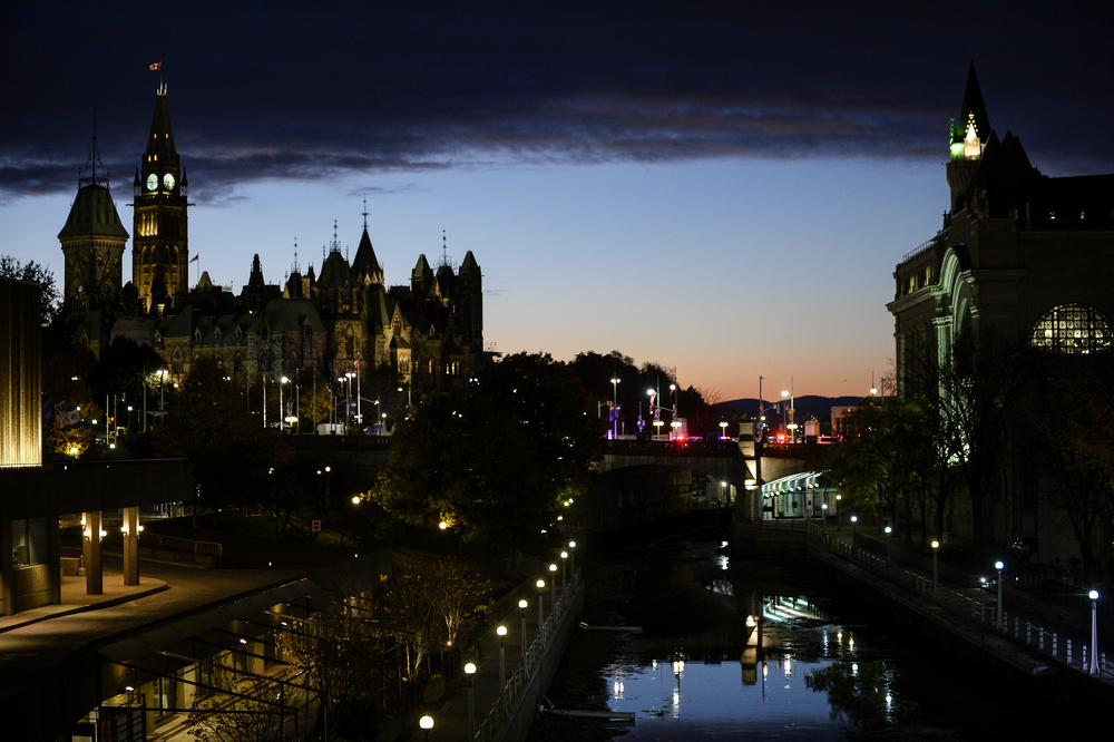 OTTAWA, Ont. (22/10/14) - Flashing lights form emergency vehicles can be see over the Rideau Canal blocking off Wellington St after a deadly shooting spree in Ottawa, Ont. on Wednesday Oct. 22, 2014. Photo by Andrew Lahodynskyj/