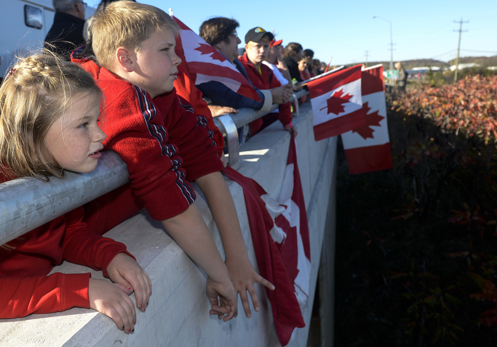 TRENTON, Ont. (24/10/14) - 8 year old Natalie Butler (left) and 11 year old Set Butler came out to pay their respects to Cpl. Nathan Cirillo on an overpass in Trenton, Ont. on Oct. 24, 2014. Cpl. Cirillo succumbed to his injuries after a deadly morning shooting at the National War Memorial in Ottawa, Ont. Photo by Andrew Lahodynskyj/special to the Star
