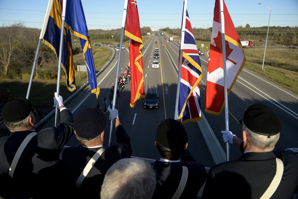TRENTON, Ont. (24/10/14) - The procession passes under the Glen Miller Rd. overpass in Trenton, Ont. on Oct. 24, 2014. Cpl. Nathan Cirillo succumbed to his injuries after being shot while standing guard at the Tomb of the Unknown Soldier at the National War Memorial in Ottawa, Ont. on Wednesday. Photo by Andrew Lahodynskyj/Special to the Star