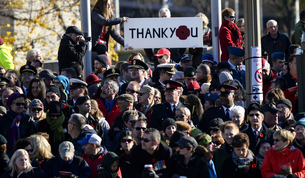 OTTAWA, Ont. (11/11/14) - People show their support for those who served and for those who have lost their lives in support of Canada during a Remembrance Day ceremony held at the National War Memorial in Ottawa on Tuesday Nov. 11, 2014. Photo by Andrew Lahodynskyj/