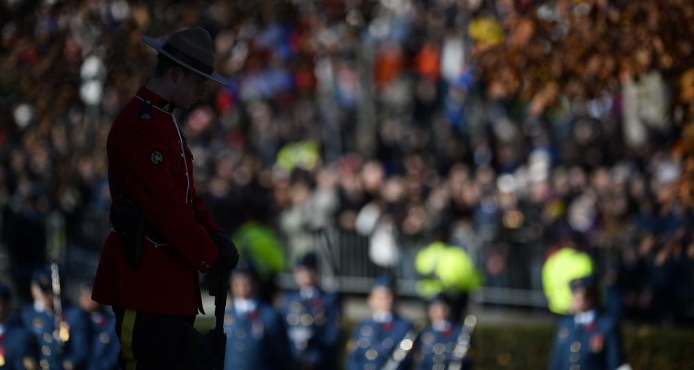 OTTAWA, Ont. (11/11/14) - A member of the Royal Canadian Mounted Police stands guard at the National War Memorial during a Remembrance Day ceremony in Ottawa on Tuesday Nov. 11, 2014. Photo by Andrew Lahodynskyj/