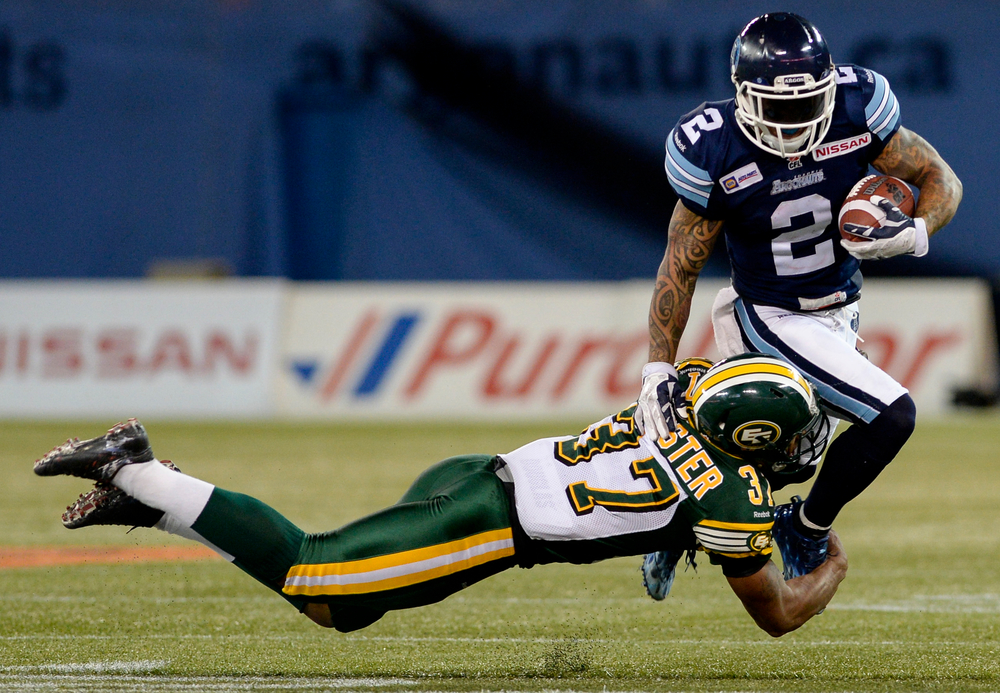 Edmonton Eskimos defensive back Otha Foster tries to tackle Toronto Argonauts slotback Chad Owens during a game at the Rogers Centre in Toronto, Ont. on Saturday Oct. 4, 2014. The Argos manage to squeak past the Eskimos 33-32.