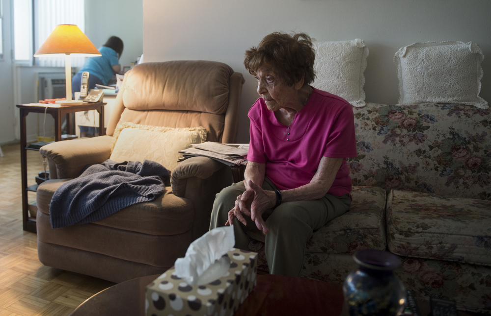 Mervis Worotynec rests in her home in Toronto's west end discussing possible alternatives for her daughter Donna, background, if something were to happen to her. Donna is 48 years-old and has down syndrome, but still lives a very independent life.
