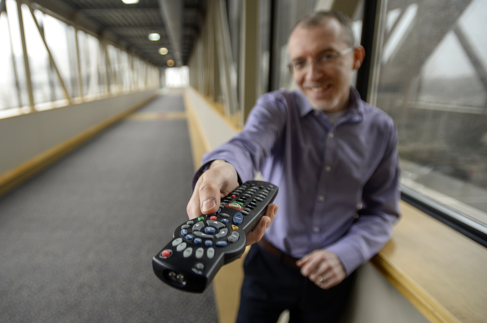 """David Stevens is one of about 1,000 Rogers Cable """"Pick and Play"""" customers. This build your own package was first rolled out four years ago in London, Ont. He is pictured on Wednesday March 25, 2015. Stevens pays $20 per month for a basic """"skinny basic"""" which only includes Canadian channels, and pays an extra $27 per month for his choice of 15 channels. ANDREW LAHODYNSKYJ/ The London Free Press /QMI AGENCY"""