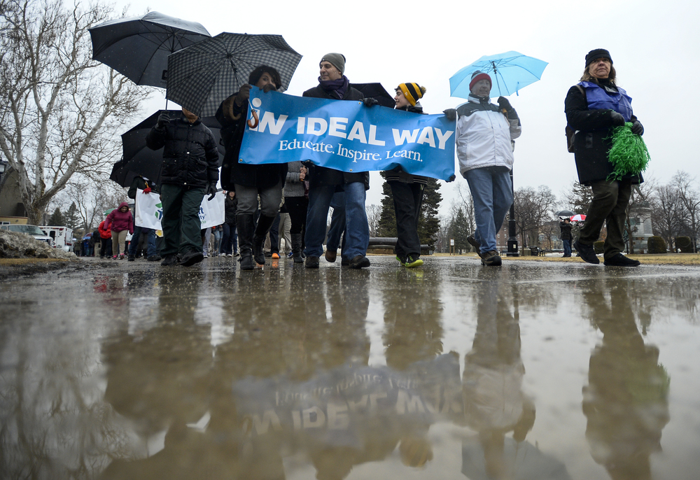 Participants of the Walk for Inclusion brave the cold and wet weather to walk through Victoria Park in London, Ont. on Wednesday March 25, 2015. This is the third annual walk organized by Ideal Way co-founders Addie Daabous and Robert Hajjar. ANDREW LAHODYNSKYJ/ The London Free Press /QMI AGENCY