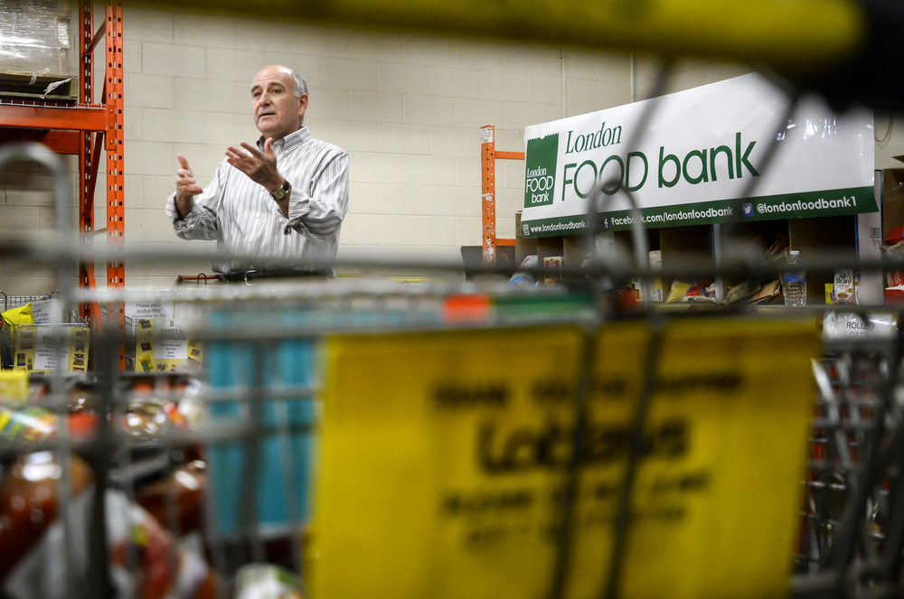 Glen Pearson, Co-Executive Director of the London Food Bank, speaking at a press conference at the food bank in London, Ont. on Thursday March 26, 2015. The food bank announces its return of the spring food drive. ANDREW LAHODYNSKYJ/ The London Free Press /QMI AGENCY