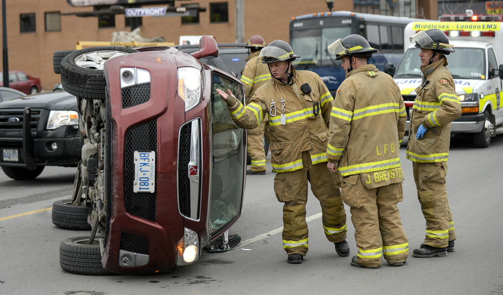 Emergency crews responded to a vehicle rollover on York St near Talbot St.  in London, Ont. around 4:45 p.m. on Thursday March 26, 2015. Two vehicles were involved in the accident, and only minor injuries were reported. ANDREW LAHODYNSKYJ/ The London Free Press /QMI AGENCY