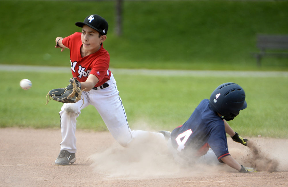 East York Bulldogs Michael Philip attempts to tag out Etobicoke Rangers Nicky as he steals second base during a game on Sunday afternoon at Stan Wadlow Park.