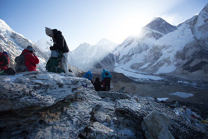 Sunrise on Kala Patthar (Everest in the far background). After having visited Everest Base Camp the afternoon before, the group makes an early sunrise hike up to the high point of the trip: Kala Patthar at 18,514 ft (5644 meters). Photo by Joel Addams