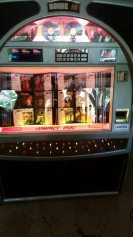 Rowe AMI CD Jukebox Does work and has over $1500 worth of music already on it!