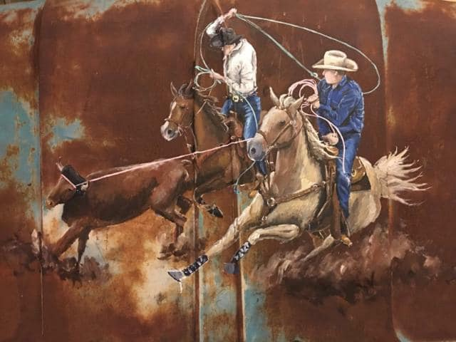 Team Roping Scene painted on a 1961 GMC Hood. Painted by renowned Texas artist George Hensley.
