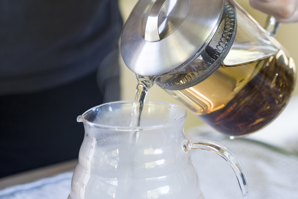 Pour tea. Make sure to decant excess liquid to prevent tea from over steeping.