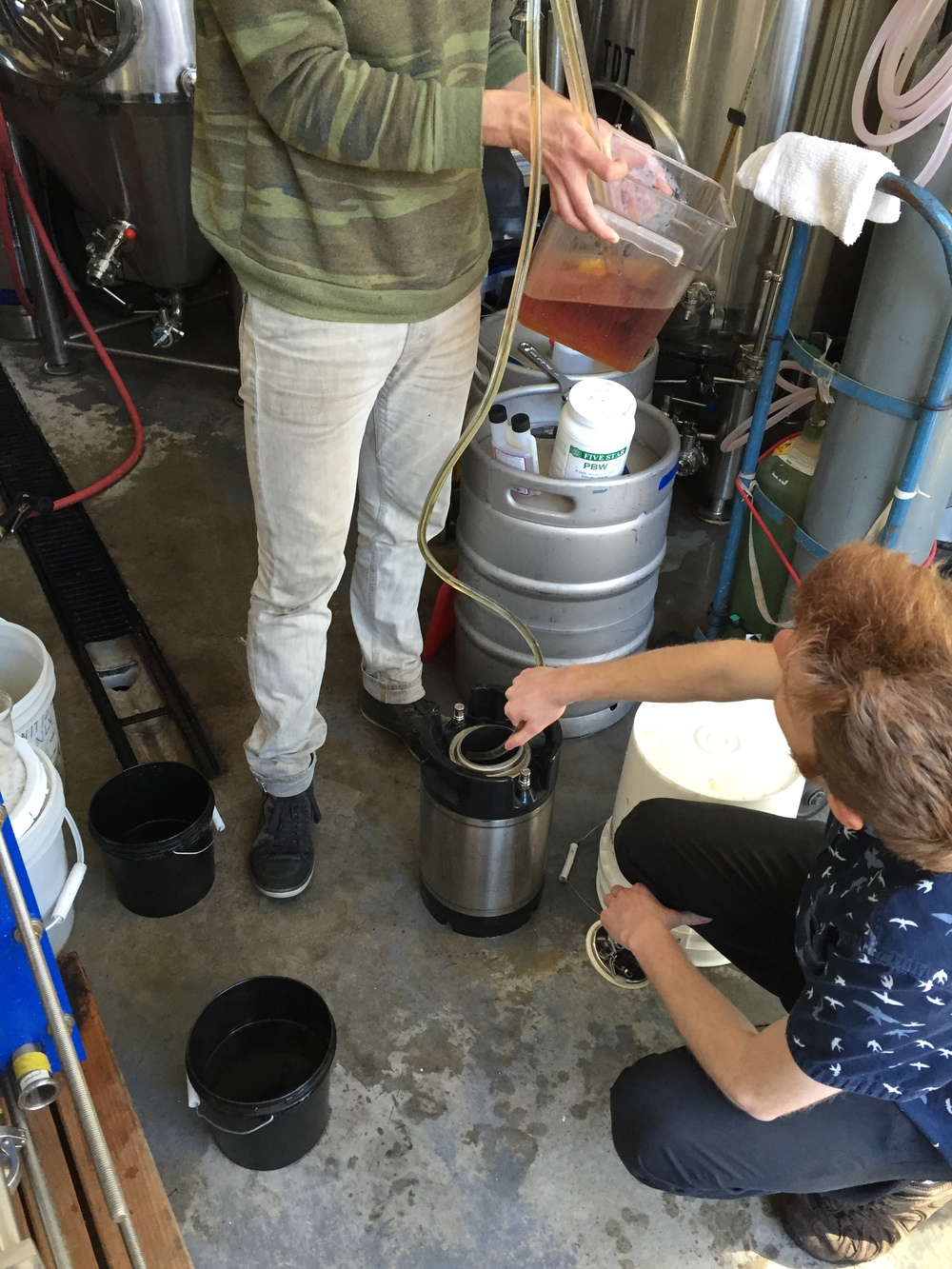 We place our cold-brewed black coil tea into the baby keg.