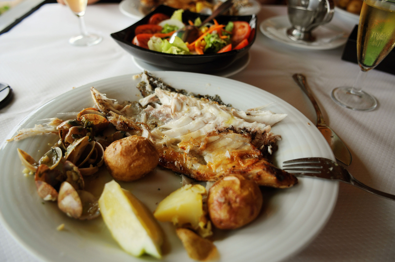 "Simple but exquisite;  potatoes, fresh fish and  ""Caracóis"" (    in Portuguese,   Snails in English    )"