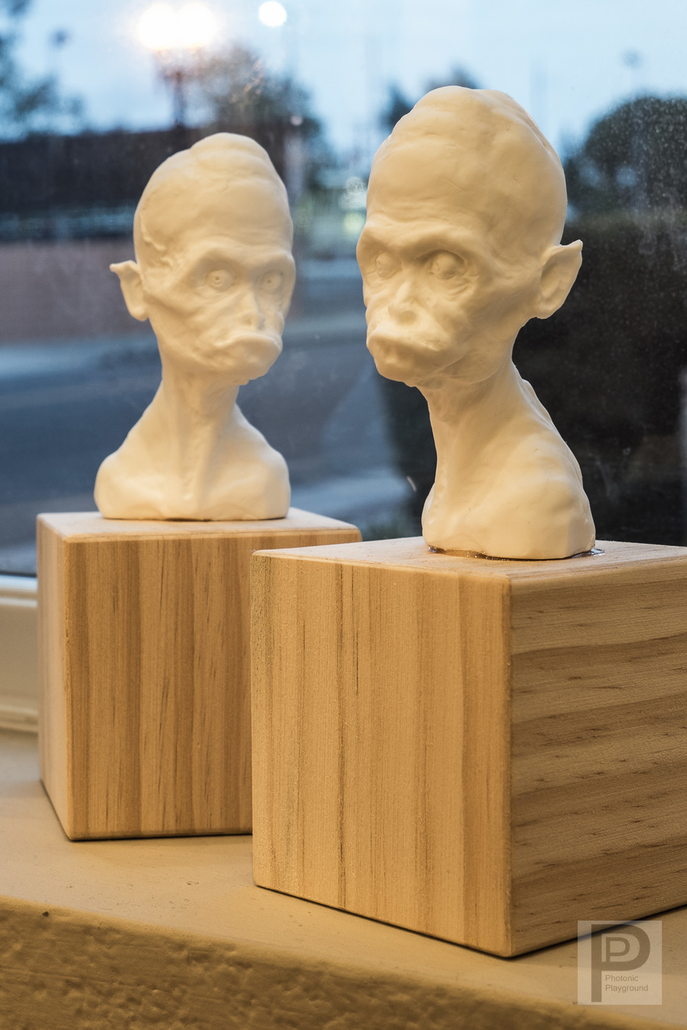 "Resin copies of the ""Tata"" sculpt."